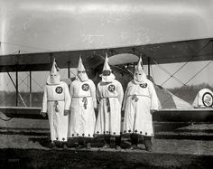 """March 18, 1922. """"Members of the Ku-Klux-Klan about to take off with the literature which was scattered over the suburbs of the city."""""""