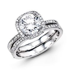 FAVORITE.....Passion Collection  This gorgeous 18K white engagement ring and band is comprised of .50ctw round white Diamonds.  MR1840-A