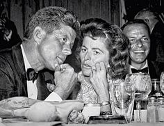 1960. 10 Juillet. JFK chats with sister Pat during fundraising dinner at the Beverly Hilton Hotel, with VIP guests such as Frank Sinatra (rt). Photo, L.A. Mirror-News