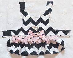 Adorable Dog Harness Dress to walk your pet in style and comfort.  This dog harness dress has a ruffled skirt with ruffle trim and matching bow. The bodice is fully lined and the harness dress closes with Velcro. It is so comfortable to wear. All of my items are made out of quality fabrics. A real attention getter!   IMPORTANT REMINDER:  Please measure before purchasing! Please check your actual measurements in case I need to adjust. If not it will be as stated. Girth (right behind the front…