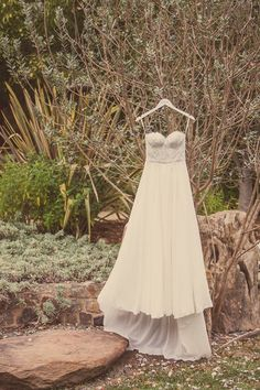 A whimsical strapless wedding dress with delicate lace details. | Image by Kreate Photography