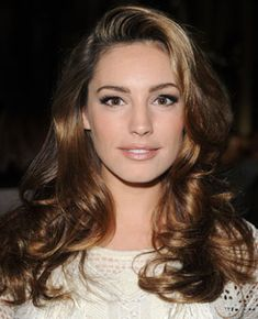 Kelly Brook wore her long glossy locks locks in loose curls at the Giles Deacon Spring 2012 Fashion Show during London Fashion Week