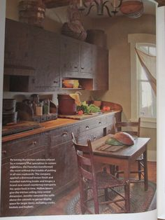 January 2012, p.46 ~ I LOVE this kitchen area!!  They redid the cabinets in brown, and it looks terrific!  But my FAVORITE thing is the drawer shelf on the counter that has the glass jars on it -- I LOVE that!  And I love the gathering of the jars!!  It all looks so primitive and HOMEY! :-)