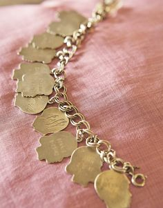 I would love to try one of making one of these for Grandma for Motther's day.   Vintage Silhouette Charm Bracelet I HAVE THESE