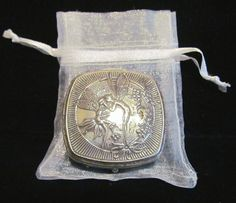 This is a gorgeous little vintage 1920's Djer Kiss silver plated powder, rouge and double mirror compact with a wonderful kissing fairies design by Maxfield Parrish. This piece has a beautiful raised