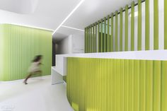 Healthcare design typically prioritizes privacy, but at Clemente Dental, a new clinic in Madrid, the client asked that transparency be gi. Interior Design Magazine, Polyurethane Floors, Dental Cabinet, Healthcare Design, Clinique, Shades Of Green, Interior Architecture, Madrid, House