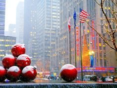 Giant ornaments are displayed annually during the holidays at different locations in NYC, including Rockefeller Center (across the street from Radio City Music Hall) on 6th Avenue.