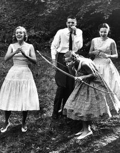 """Old school style. Teenage party, Briarcliff, New York, 1950. *Nothing says """"partaayyyy"""" like putting on your nicest tea-length party dress and breaking out the bow and arrows.*"""