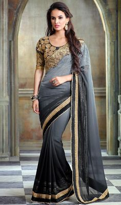 Give enchanting look to the crowd dressed in this black and gray color shade georgette sari. It has been beautifully created with lace, resham and stones work. Upon request we can make round front/back neck and short 6 inches sleeves regular saree blouse also. #floralworksarees #georgettesaris #womensareeonline