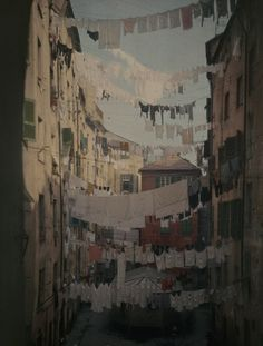 Autochrome: Hans Hildenbrand. Genoese families hang laundry between buildings to dry. Genova, Italy.