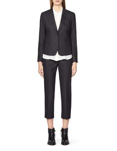 """Women's short fitted blazer in stretchy pinstriped fabric. Features a single button fastening and buttons at the cuffs. Two front pockets and single chest pocket. Fully lined. Slim fit. Hip length.  </br></br>For a complete suit look wear it with <a href=""""http://tigerofsweden.com/se/trousers/boutis-trousers-S63936003.html"""" style=""""font-weight:bold; text-decoration: underline;"""" target=""""_blank"""">..."""
