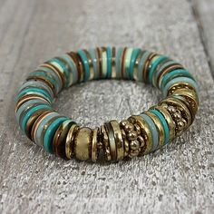 Turquoise Buttons Bracelet. LOTS of great button crafts in this post.