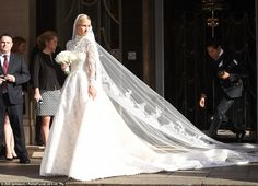 Blushing bride: Nicky Hilton leaves Claridge's hotel in London en route to her wedding at Kensington Palace - July 10, 2015