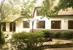 Located in Hogsback on the Eastern Cape of South Africa, this thatched-roof hotel offers rooms or self-catering cottages surrounded by native forest. Best Holiday Destinations, London Airports, Self Catering Cottages, Bright Rooms, Thatched Roof, Comfy Bed, East Africa, East London, Mountain View
