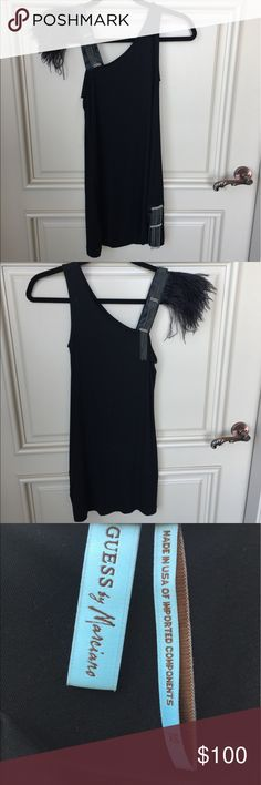 Guess by Marciano One Shoulder Tank Guess by Marciano One Shoulder Tank with feather embellishment. Super sexy with black leggings and your favorite pair of blak. Pumps,thigh high boots or booties!. Size XS. In brand new condition Guess by Marciano Tops Blouses