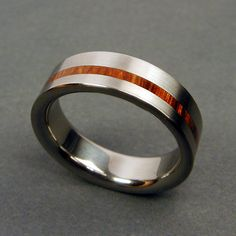 rosewood pinstripe ring..This is So my husband!! I think I will get this for him when we have kids for a father ring!!