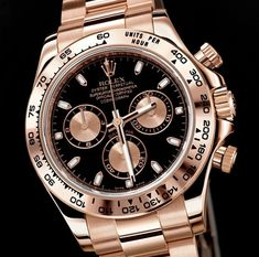 Rose gold watch with black face by Rolex. I'm in love with rose gold. Just wish it didn't cost $30,000! O.O