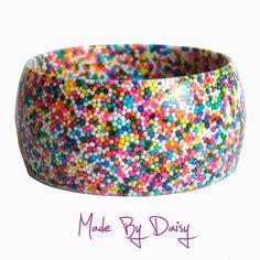 Rainbow candy resin bracelet cake sprinkles hundreds and thousands. £25.00, via Etsy.