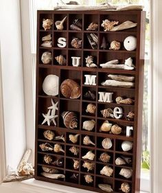 Displaying a seashell collection in a printer tray, adding letters that spell out summer. by jamie_1