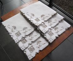 Description Italian Hand Embroidered TABLE NAPKINS Set of Six 41cms x 41cms Needlepoint / Cutwork is in Taupe and finished off in contoured scalloped edge 'Never Used' Stored over a long period of time so I have *Washed *Starched *Ironed to freshen up.