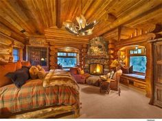 cozy log cabin bedroom with fireplace #LogHomes