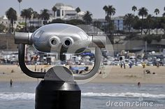 Commercial telescope with view of the water, beach, people and city of Santa Monica, California
