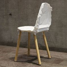 The seat and backrest of Ryan Jongwoo Choi's Crumpled Chair are formed by pouring a thin layer of resin over a faceted aluminium-foil framework covered with a plastic bag.