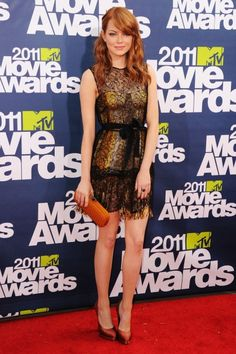 Love Emma's red hair - and the dress is sassy.