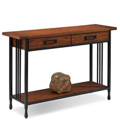 Features:  -Ironcraft collection.  -Custom Rato Design two piece drawer hardware.  -Blackened metal mission slats.  -Cinched metal toe design.  -Lower display shelf.  -Full extension ball bearing draw
