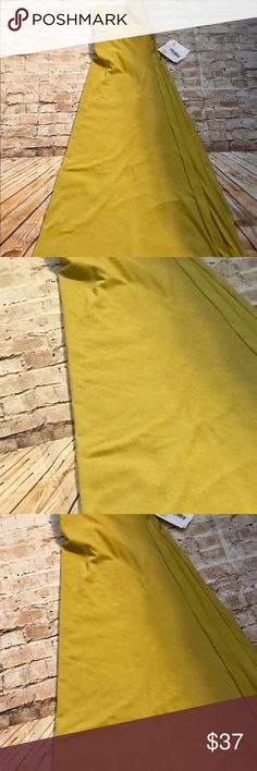 LuLaRoe maxi skirt size medium 💛💛💛 Really pretty mustard yellow color. Great cotton feeling thick material💛💛 brand new with tags. Size medium 💛💛💛 LuLaRoe Skirts Maxi