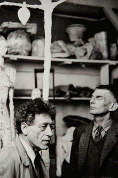 Beckett and Giacometti, 1961. In Giacometti's studio, with the Tree sculpture that Giacometti created for Waiting for Godot.