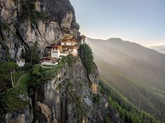 "Paro Taktsang, also known as ""The Tiger's Nest"" monastery, hangs on a cliffside precipice more than 10,000 feet above the ground. If the intricate temple complex doesn't wow you, then the sweeping views of the Paro valley surely will."