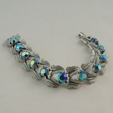 Vintage Coro Aurora Borealis Bracelet Brushed Silver Tone from Antik Avenue on Ruby Lane SOLD