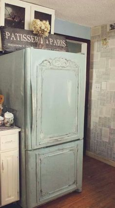 Love this.....adding a wooden frame onto the door panels. Painting and white washing the fridge a pretty color. LOVE