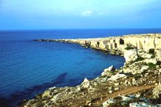 Favignana coast with tufa stone blocks in background