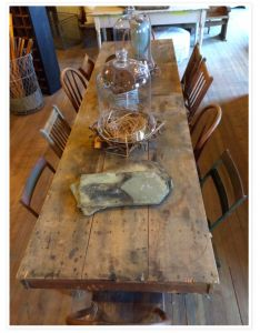 old farm table with mismatched chairs