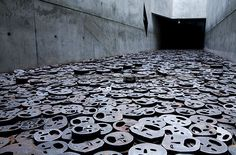 Metal faces Representing Holocaust Victims In The Jewish Museum, Berlin