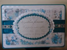 Beautiful wedding card with peacock blue as the feature colour. Sentimental wedding paper as centre cut out and layered with differing papers, wide ribbon to add texture against the background. blue, peacock, weddings, mr and mrs,, flowers, scalloped edging, ribbon.