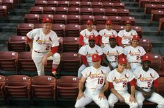 Members of the 1968 St. Louis Cardinals — manager Red Schoendienst (2), Roger Maris (9), Tim McCarver (15), Orlando Cepeda (30), (Middle L-R) Bob Gibson (45), Curt Flood (21), Julian Javier (25), Mike Shannon (18), Dal Maxvill (27), and Lou Brock (20)