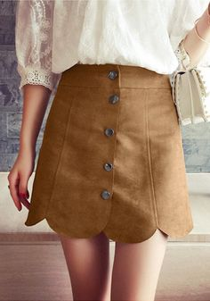 This ultra-chic brown suede scallop hem miniskirt is made in brown suede which features snap-buttoned front and designed with scallop hem detailing.   Lookbook Store