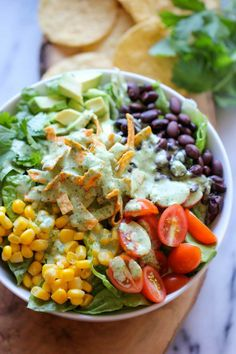 Clean eating with amazing flavor! Southwestern Chopped Salad with Cilantro Lime Dressing - A tex-mex style salad with an incredibly creamy Greek yogurt cilantro dressing! Mexican Food Recipes, Vegetarian Recipes, Cooking Recipes, Healthy Recipes, Delicious Recipes, Kale Recipes, Yogurt Recipes, Avocado Recipes, Tasty