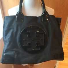 Tory burch Ella tote Large authentic Tory burch Ella tote black vinyl and patent leather has some markings inside Tory Burch Bags Totes
