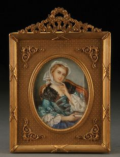 A VERY FINE FRENCH MINIATURE IVORY PORTRAIT, 19TH CENTURY.  Finely painted depicting a seated young beauty with book within a gilt bronze frame with ribbon scrolled crest. The ivory height 3.75 inches (9.5 cm), overall height 7.5 inches (19. cm).