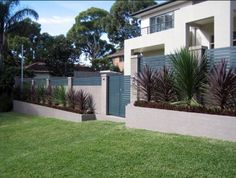 Fence Designs By Modular Wall Systems   Block Wall Of Concrete Pillars With  Wooden Slats In And With Mini Feature Gardens To The Front