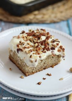 This Banana Cake with Pineapple Cream Cheese Frosting is a creamy dessert recipe that everyone will love! Be sure to top this creamy dessert with nuts for the perfect amount of crunch.
