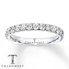 This elegant Tolkowsky® wedding band is fashioned with round diamonds totaling 3/4 carat in weight. The ring is crafted of 14K white gold. Diamond Total Carat Weight may range from .69 - .82 carats.