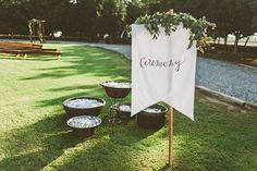 modern boho outdoor wedding ceremony | banner sign with hand lettering and greenery | | Handcrafted Orchard Ranch Wedding | modern boho bohemian rustic private property wedding