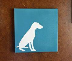 paint wood solid, cut out stencil of animal, paint over and remove