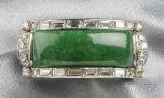 14kt White Gold, Jadeite, and Diamond Saddle Ring, set with a shaped jadeite measuring approx. 22.50 x 9.00 x 3.80 mm, framed by baguette- and single-cut diamond melee, engraved accents. Undated but I think it's Art Deco or Art Deco style