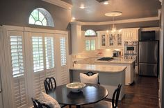 LOVE - Like the granite color for the island, love the wall color, love the black painted kitchen tables and chairs Kitchen Wall Colors, Kitchen Layout, Kitchen Decor, Kitchen Ideas, Kitchen Inspiration, Kitchen Designs, Interior Shutters, Kitchen Shutters, White Shutters